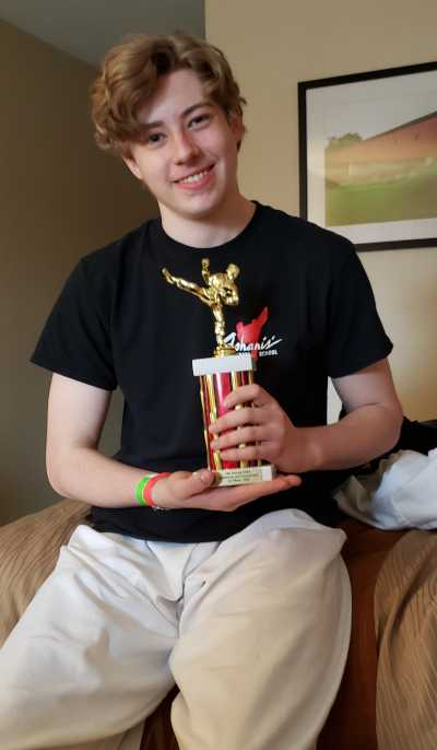 david holding third place trophy - karate tournament